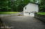 The driveway is paved with turn around space.