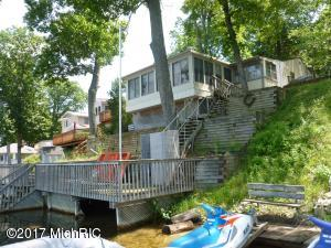 Lakefront view of home. Terraced yard to lakeside deck.