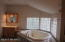 Master Bath with Jacuzzi tub, dual sinks and private water closet
