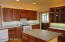 Large kitchen with Cherry Cabinets with ceiling accent lighting