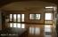 Large Living Room and Dining area wall of windows facing Lake Michigan. Hardwood floors