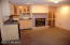 This wine room, in the lowest level, has a refrigerator, wet bar and small fireplace with gas lot. The room is charming.