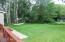 Spacious backyard for entertainment.