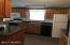 Nice Kitchen with stove refrigerator, microwave and dishwasher