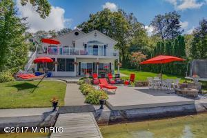 Enjoy Lake living with this beautiful home on over 90' of prime shoreline!