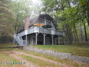 9520 Golfport Drive, Canadian Lakes, MI 49346