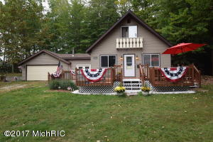 11957 Red Feather Lane, Canadian Lakes, MI 49346