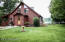 Amish built log home on 63 acres on private lake.