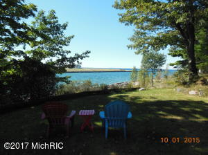 View from front lawn and deck looking out channel into Lake Michigan.