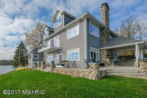 7,000 sq ft of living space on 185'+ (ALL SPORTS 530 acre Wall Lake waterfront!