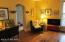 Unit 1 living room with handsome refinished hardwood flooring