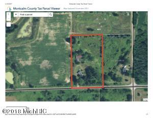 Great piece of heaven to call your own on nearly 4 acres just outside of Sheridan on a paved road.  Parcel currently has existing well, 2 septic systems, and 2 electrical services.  There are also 2 cement pads for mobile homes.  Large 40x60 mostly steel framed pole building with attached 24x40 garage with cement floor, power and water.  With a bit of elbow grease could be working farmstead, machine shop, auto property and a season stream that runs through the front corner of property.  There is 3 phase electric at the end of drive for your high power needs.  Call for your private showing today.  Permission needed to walk property!!