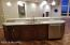 Kitchen island with snack bar. Granite tops.