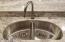 Double basin (under-mount) kitchen sink in granite.