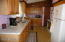 The kitchen has appliances new in 2008. The far cabinet is set up for a washer and dryer if owner prefers.