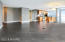 Open floor plan (kitchen, dining, living area)