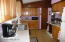 This galley kitchen has newer appliances and is very convenient.