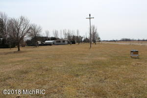 Beautiful, quiet, corner lot ready to be built on! Minutes from the highway and short drive to Downtown GR or head up north for a weekend. Easily cleared for building with only a handful of trees to remove. Land has been perked and surveyed!  Don't miss this opportunity to build your dream home.