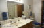 Bathroom off Hallway and Master Bedroom Closet