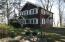 Built in 1935 this 6 bedroom Log Cabin sits prominently overlooking Lake Michigan.