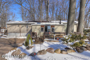Pride of ownership shows in this property.  Home is almost completely rebuilt and features 3 bedrooms with a stellar lake view from the master.  Also includes a full bath with tub, main floor laundry, and real 2x wood floors in the main living area. The large addition makes the living room feel spacious and has a wood burner to stay cozy by while enjoying the fire.  Propane furnace is newer along with mostly newer Anderson windows.  Walls are now 2x6 with multiple layers of insulation sitting on concrete foundation.  The landscaping is serene and the large back yard is fenced in with an oversized gate which allows an RV or 5th wheel to be stored inside the fence.  Further features include fire pit and large back deck.  If you looking for that weekend get away, call for a showing.
