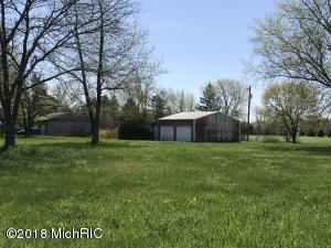 Prime Property, Vacant Commercial Lot with old garage.