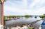 View down river of Coast Guard and railroad bridge