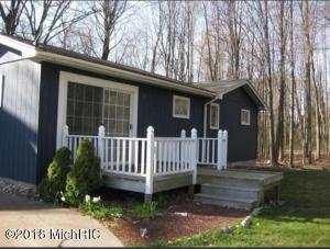 Come and See: All the updates this 3 bedroom, 1 1/2 bath home has to offer. Spacious kitchen with granite counter tops, snack bar, stainless appliances, wood flooring and dining area. Large living room with fireplace and new carpeting. French doors off living room to the backyard and deck.  bedroom with slider to another deck offers a great spot for relaxing. Full bathroom features granite countertops and double sinks and mirrors and dual access from the main living area and bedroom. Single stall garage with storage. Enjoy the wooded backyard, deck and fire pit. This home is located at the end of a cul-de-sac street for peaceful living.Walk down the street for beautiful views of Spring Lake or take a walk along the bike path. With interest rates still low, this would make a great home!