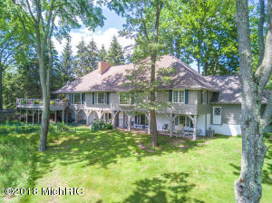 This beautiful waterfront home overlooks Lake of the Clouds to the south and the Highlands Golf Course area to the north.