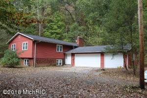 This 4 bedroom, 2 bath home sits on 5.3 wooded acres between Lowell and Saranac.  The home features a full Mother in Law apartment downstairs, Large living and dining room upstairs, large, finished family room in the basement, large deck, 3 stall garage, and the home has been wired for a generator.  Home has central air. UPDATE 8/15/18:  The Septic tank was pumped and the well and septic systems were inspectedHome back on Market 8/9/2018  Buyer financing fell throughAll remaining possessions in home to stay with the house.Schedule your showing today, this home will not last long.The REALTOR is related to the owner and has an interest in the home.All information is correct to the best of our knowledge but should be independently confirmed.