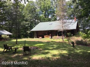 112 acres with large log home and Little Muskegon River frontage estate property-
