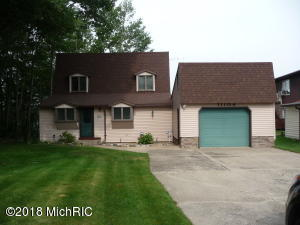A one car garage attaches to the home for easy entry. Plenty of room and access with cement driveway and paved road.