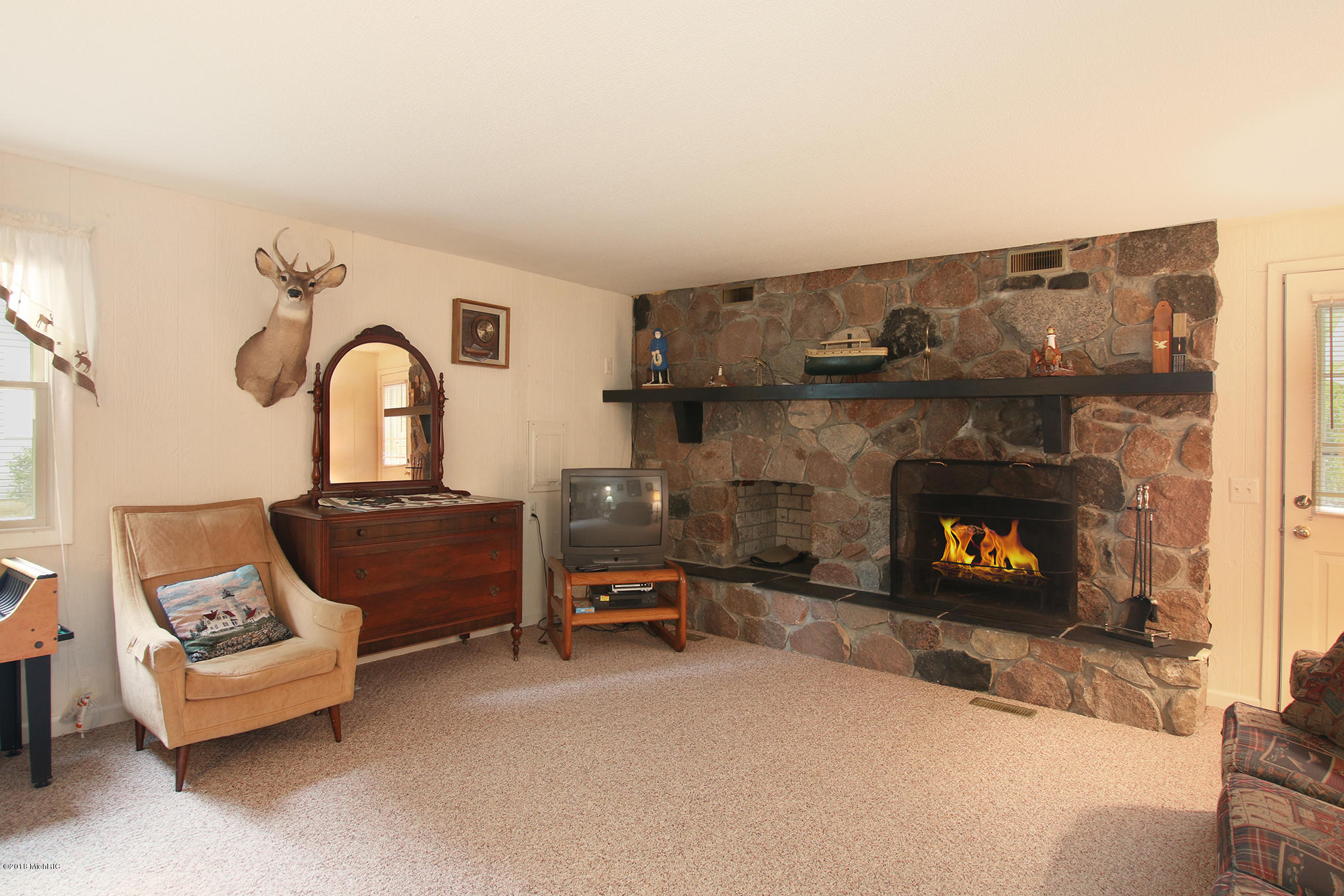 Family room with fireplace & wet bar