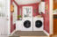 Convenient laundry/mud room off entrance and kitchen.