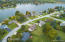 Short 1/2 Block to shared beach area and backs up to green area with 2nd lake access!