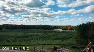 ''Sky View'' Orchards. 37 A  M/L Rolling Acres on the Scenic Corner of S Lakeshore & W Meisenheimer. Over 2000 feet of road frontage . 4000 square foot Farm Market Building on S Lakeshore , 40 X 60 Pole Building on top of the hill  plus a Historic Barn. Several permitted uses with Agricultural Zoning including Sand & Gravel Mining, Wineries, Churches,  etc. 33 ML acres subject to the terms and condition of a certain agricultural lease dated 11/14/2012. See MLS #18049042 for Home, Shop and Horse Barn.