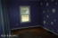Bedroom with hard wood floors waiting just waiting for your personal touch