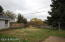 Large fenced in yard overlooking the river