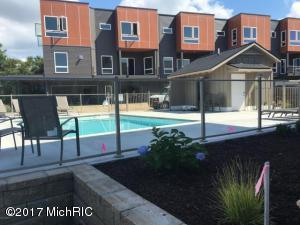 Modern loft living on the waters edge of Lake Macatawa. Relax in the pool or read a book while watching all the boats and activity on the lake.