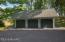 Three car garage with indoor/outdoor Kennel area