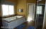 The master bath has a spa tub, privacy stool, his and her walk in closets and vanities and a spa tub and over-sized shower are luxurious.