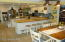 """Custom """"Country"""" Kitchen with snack bar and eating area."""