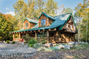 "This custom log home  is nestled in the woods, on 17+ acres, w/1700' of private frontage on the St. Joseph River, offering great boating and fishing. This private setting with the 'Up North' feel is less than 2 hours from Chicago, & only 10 miles from Notre Dame. Walk to restaurants, a movie, or the YMCA in Niles, a town of 12,000. Shopping at big box stores is 17 miles away, in Mishawaka. The house itself is extraordinary, made with 100 yr old White Pine logs from Ontario, with a 'magazine quality' interior design. Douglas Fir floors & ceiling, two massive stone fireplaces, limestone counter tops, & high end appliances.  In addition, the private guest quarters above the detached 3-stall garage offers great space for family or friends.  High speed internet & CATV, city water & natural gas. Douglas fir floors are varnished. Ceilings are white washed. Main level interior doors are from a 100+ year old home in Buchanan, MI. Kitchen counter tops are from a limestone quarry in Wisconsin. Logs are massive, averaging 24"" in diameter, hand hewn and full Scandinavian scribed.  1,500 square foot guest quarters are above the garage. One bedroom, one bath, and large living space, with full kitchen. Natural gas, forced air heat, and AC.   3-car garage has radiant heat throughout.  Electric and natural gas lines are buried."
