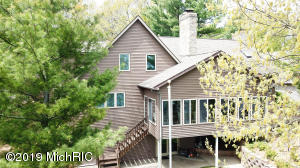 7980 Island Court, Canadian Lakes, MI 49346