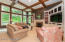 The living room features coffered ceiling