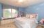 upper level bedroom w/ built in bench and Jack & Jill bathroom