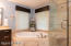 luxurious master bathroom with soaking tub and tile shower