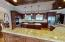 Re-mastered gourmet kitchen in 2019, includes new granite counters and back splash, a new stainless steel appliance suite, new professional grade plumbing fixtures and high-end lighting fixtures.