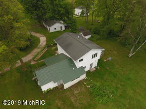 9125 Musson Road, Six Lakes, MI 48886