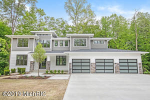 2019 Mid Century Modern Parade Home with all the extras.  Home is under construction with completion scheduled for the End of May.This home has amazing finishes from a Custom Design Exterior with Glass Garage Doors to the latest interior furnishing.Home is in the the New Eagle Ridge Development with an amazing wooded ravine view and private back yard.